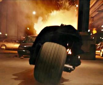 Batman On Motorcycle Blasting Cars Wallpaper