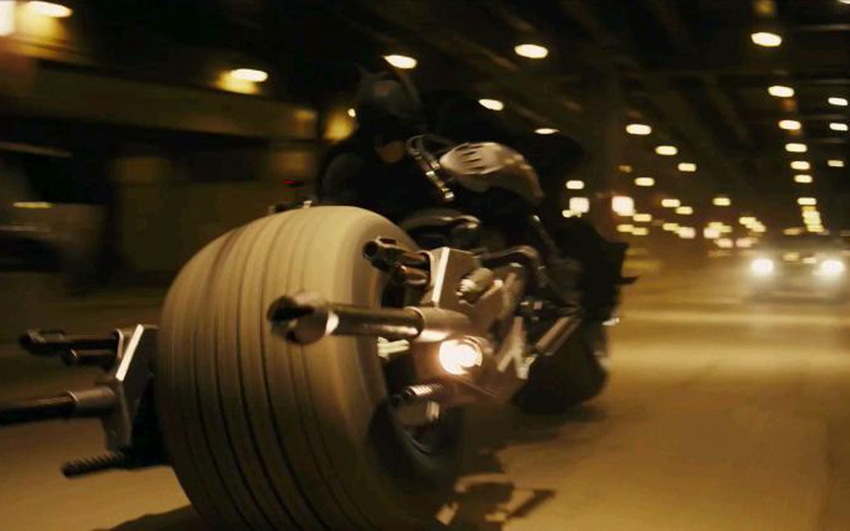 Batman Riding Fast On Motorcycle Wallpaper 1680x1050