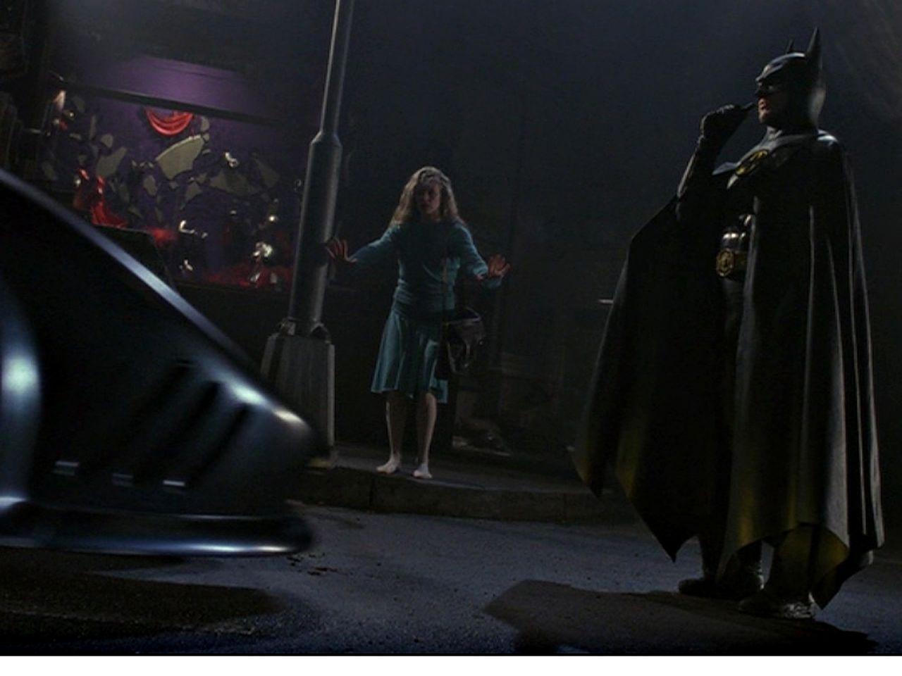 Batman Stands In Front Of Batmobile Wallpaper 1280x960
