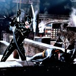 Catwoman Fights Batman On Roof Wallpaper