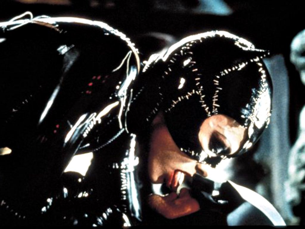 Catwoman licks batman wallpaper 1024 215 768 batman wallpapers
