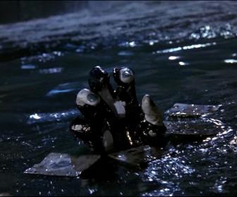 Joker Hand Emerges From Water Wallpaper