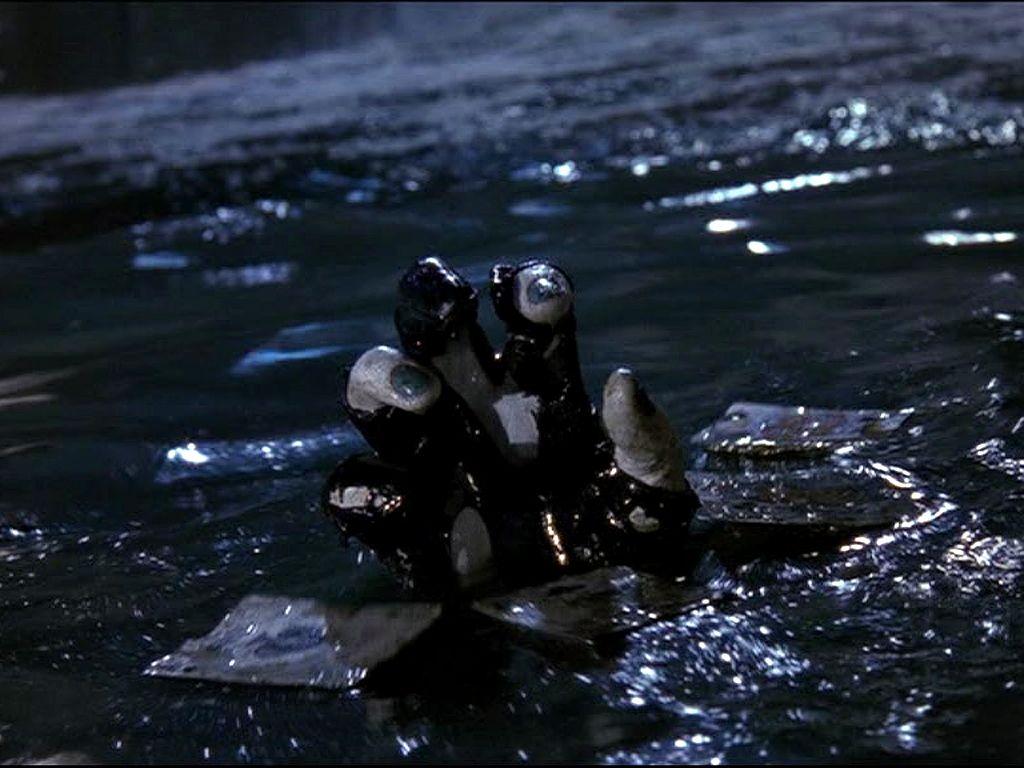 Joker Hand Emerges From Water Wallpaper 1024x768