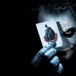 Joker Holding Batman Card Portrait Wallpaper