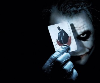 Joker Holding Batman Card Portrait Wallpaper